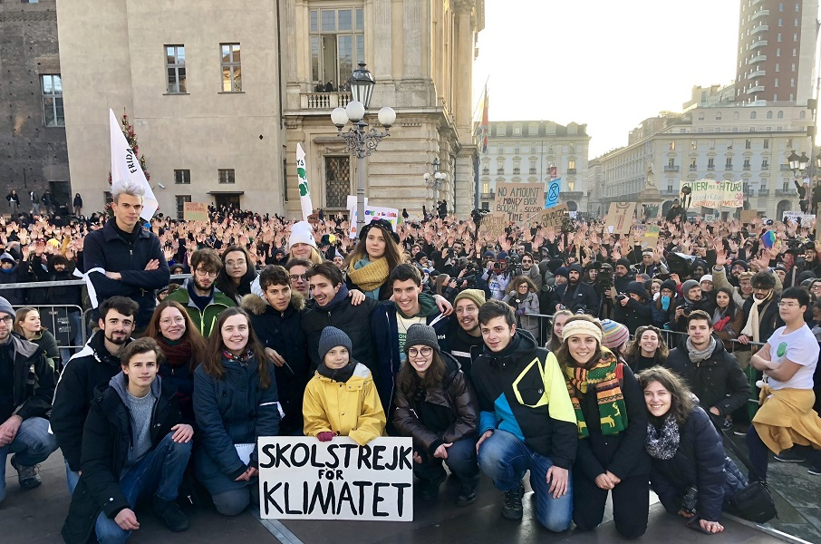 Greta Thunberg with fellow protesters in Turin, Italy